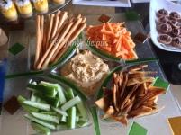 Hummus platter- pita chips, bread sticks, carrot sticks and cucumber sticks